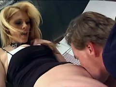Blonde dominatrix sits on slave`s face
