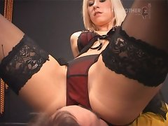 Blonde mistress smothers slave by ass
