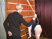 Bad schoolgirl is in the caning action