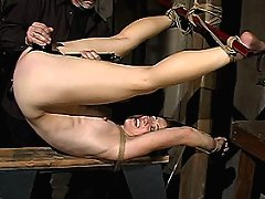 Dylan Ryan in tight bondage, spanked, denied orgasms she desperately wants, and fucked with large toys.