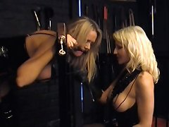 This filthy blonde just loves getting spanked and teased by her lesbian mistress