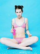 bubble blowing tatted teen strips off pink bikini
