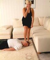 Blonde mistress tramples slave.