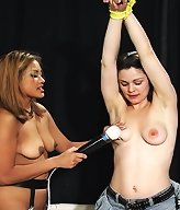 Mistress Maxine ties up her latest slave and strips her and teases her naked flesh