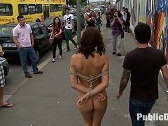 European hottie is fully nude, barefoot, and bound in the streets where everyone can see