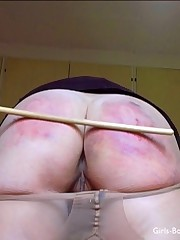 A severe caning for a student in pantyhose