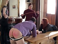 Mistress spanking two tied slaves