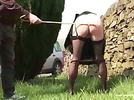 Cool ass babe in caning action