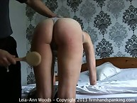 Housewife suffering from hairbrush spanking