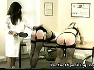 Kinky treat paddled two asses