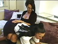 Strict lesbian teacher spanking schoolgirl