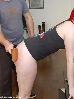 12 of The sharp CRACK of a wooden paddle spanking Alison Miller's bare bottom